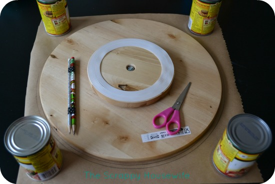 then trace around your lazy susan making sure both pencils make contact with the kraft paper