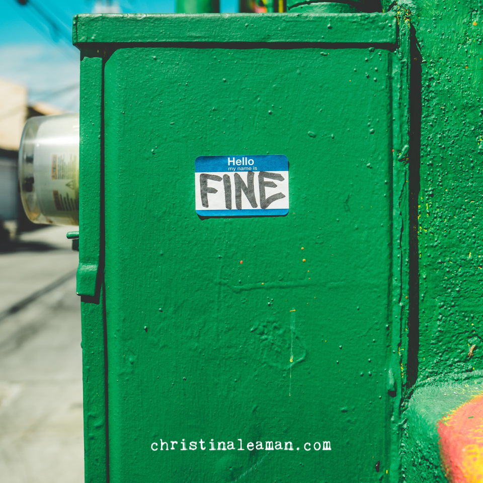 This is a picture of a green electric box with a blue and white Hello My Name Is sticker on it.